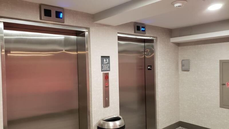 two stainless elevator entrances for Miles Elevator Door and Cab